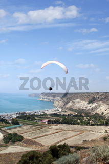 Flying paraglider in the sky,  Kourion, Cyprus