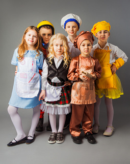 The group of kids in costumes of different professions