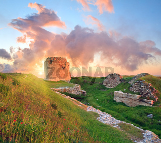 Majestic sunset and ancient fortress ruin