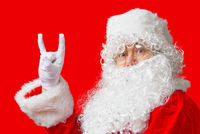 portrait of a man dressed as santa claus on a red background
