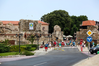 Nesebar, Bulgaria - 06/23/2013: People visit Old Town on June 23, 2013 day of Nessebar, Bulgaria. Nessebar in 1956 was declared as museum city, archaeological and architectural reservation by Unesco.