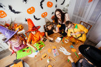 Preparations for autumn holidays doing craft with kids