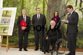 German finance minister Schaeuble gives the charity stamps to German Federal President Joachim Gauck