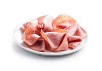 Sliced smoked salami on plate