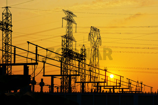 Electricity network at transformer station in sunrise