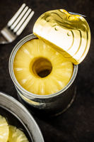 Canned sliced pineapple fruit in can.