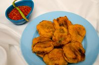 Batata Wada, famous Maharashtrian street food, Potatoes covered with gram flour, deep fried and served with spicy garlic chutney powder