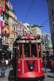 Old Tram travelling along Istiklal Caddesi street