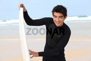 Teenager with surfboard