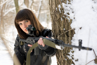 Portrait of gorgeous young lady with a sniper rifle
