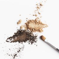 Scattered light and dark brown face shadow and eye shadow or make-up brush