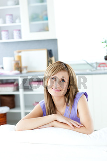 Delighted woman thinking in the kitchen