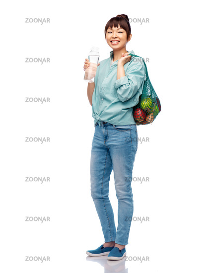 woman with food in string bag and glass bottle