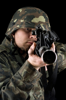 Alerted soldier pointing m16 in studio