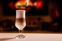 Close-up of fresh latte machiato or cappuccino. Multi layered coffee