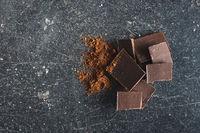 Sweet chocolate bar and cocoa powder
