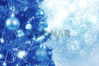 blue christmas background with balls on tree