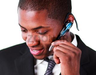 Close-up of an businessman using an bluetooth earpiece