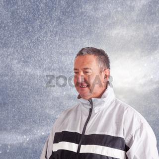 Man in rain clothing runs in the rain
