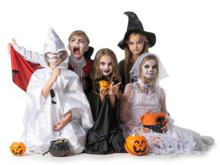 Children in Halloween costume on white