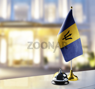Barbados flag on the reception desk in the lobby of the hotel