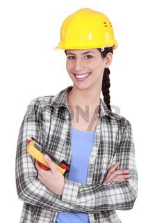 Woman holt a voltmeter