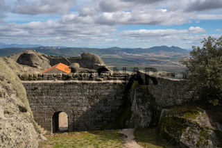 Monsanto historic castle with stone Santa Maria church and landscape view of Beira Baixa, in Portugal