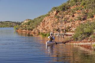 canoe paddler on a mountain lake