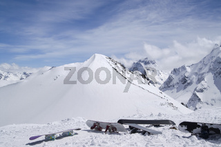 Snowboards against the top of mountain