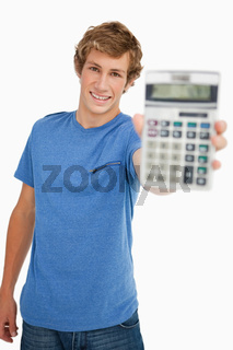 Smiling young man showing a calculator