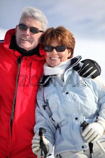 couple of elders wearing ski glasses at ski