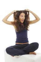 Pretty woman tries to detangle her hairs