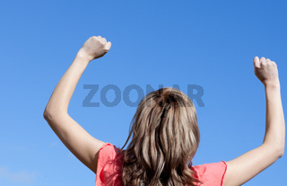 Happy woman punching the air outdoor