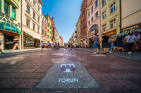 Torun city emblem sign on the pavement in Old Town