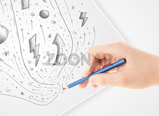 Hand drawing abstract sketches and doodles on paper