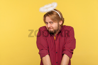 Portrait of emotional hipster man on yellow background.