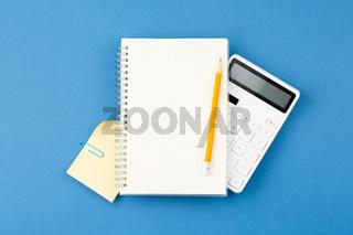 Notepad, pencil, calculator note sheet Office desk