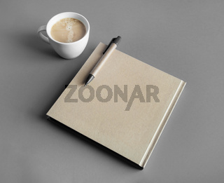 Brochure, pen, coffee cup