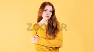 portrait of a serious young woman with her arms crossed