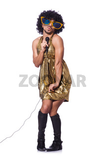 Man in female clothing singing with mic