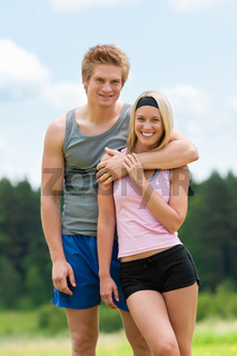 Sportive young couple happy posing in coutryside