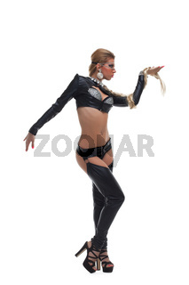 Sexy dancer in latex costume with braid