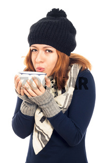 Woman in winter clothes holding mug with hot drink