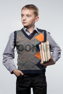 Little boy with books in hands