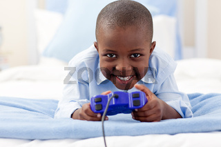 Smiling little boy playing video game