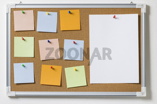 Cork board with variety of colorful, blank memos