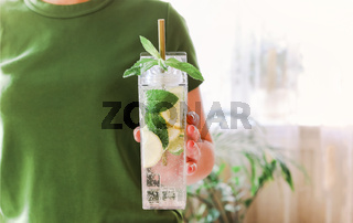 Fresh lime and mint infused water, cocktail, detox drink, lemonade in reusable bottles
