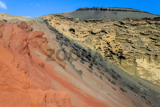 Volcanic mountain in different red, black and beige colours nearby El Golfo on canary island Lanzarote