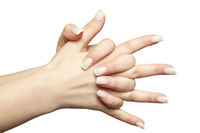 Female hands with woman's professional natural frenchnails manicure on white background