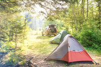 Cozy camping with tents and a car